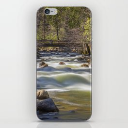 A bridge over the Merced River stands solidly over the velvety exposure of the water iPhone Skin