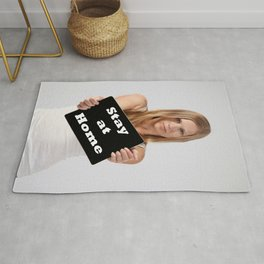 "Woman holding sign that says ""Stay at Home"" Rug"