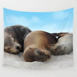Sea lions family sleeping together on beach Wall Tapestry