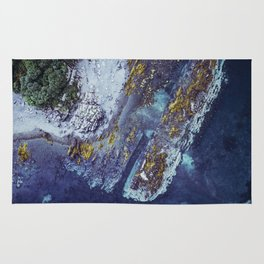 Floating over a mountain by sea Rug