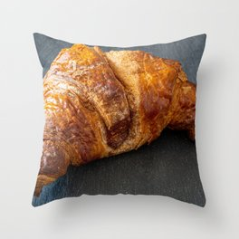 Traditional croissant placed on a dark plate Throw Pillow