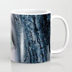 Big green eye in a blue tree Mug