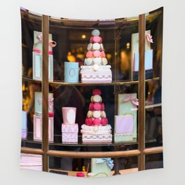 Beautiful colorful tasty macaroons cakes sweets and presents in the boxes display in window at the  Wall Tapestry