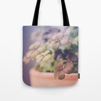 clover Tote Bags featuring Clover by Juste Pixx Photography
