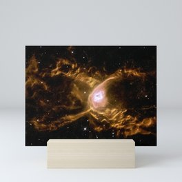 Hubble Spins a Web Into a Giant Red Spider Nebula Huge waves are sculpted in this two-lobed nebula c Mini Art Print