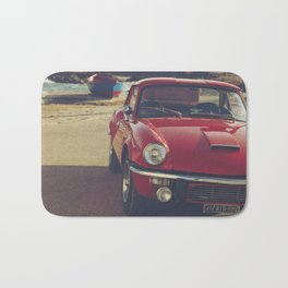 Triumph spitfire, english car by the beach in italy, old car and a boat, for man cave decor Bath Mat