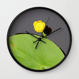 Yellow waterlily with lily pad Wall Clock