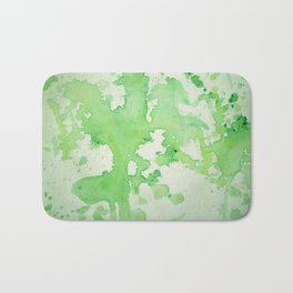 paint splatters in shades of green Bath Mat