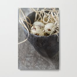 Little quail eggs in an old cup with a straw. Grey stone background Metal Print