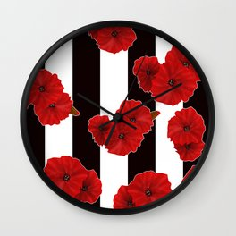 Red poppies on a black and white striped background. Wall Clock