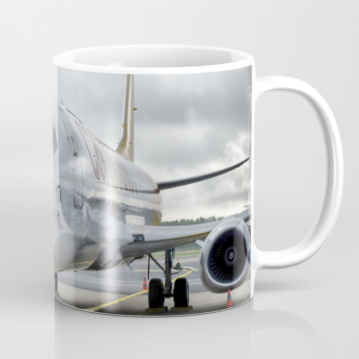 The plane at the airport on road Coffee Mug