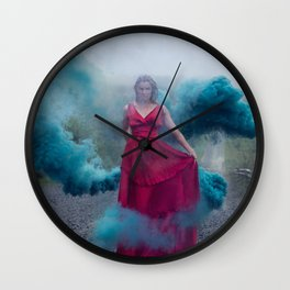 Beautiful, young and sexy female vampire style in a red dress with smoke outdoors. Wall Clock