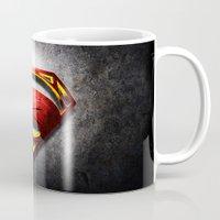 man of steel Mugs featuring Man of Steel by bimorecreative