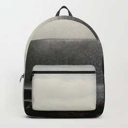 The ocean behind the wall Backpack