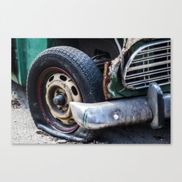Flat tire on smashed vintage car Canvas Print