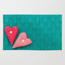 saint valentine green textured knitted background with hearts Rug