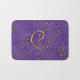 Golden Embossed Yin yangsymbol  on purple Bath Mat