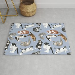Lounging Cats in Blue Rug