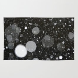 Light in the Dark-Photo of light colored circles on a dark surface Rug