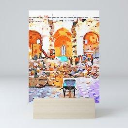 L'Aquila: wheelbarrow scraper and fireman in the interior of church destroyed Mini Art Print