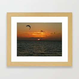 Sunset in the calm sea with red sky, gray cloud and a parachute Framed Art Print