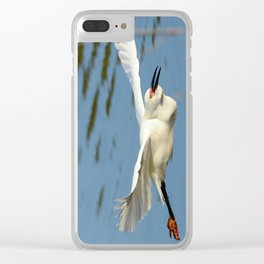 A Snowy Egret wings its way across the lake to a fishing spot Clear iPhone Case