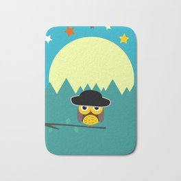 Clear night with a cute owl on a tree branch Bath Mat