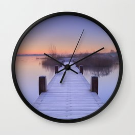 Boardwalk on a lake at dawn in winter, The Netherlands Wall Clock