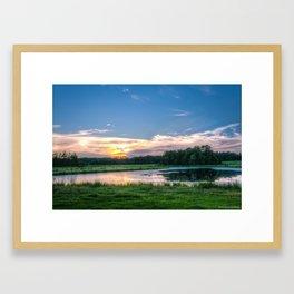 Sunset Over a Pond Framed Art Print