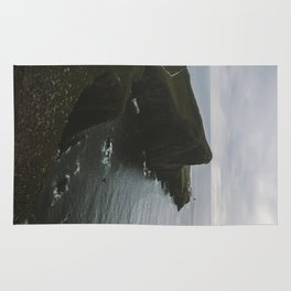 Neist Point Lighthouse at the Atlantic Ocean - Landscape Photography Rug