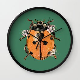 Ladybug on green with mini flowers Wall Clock