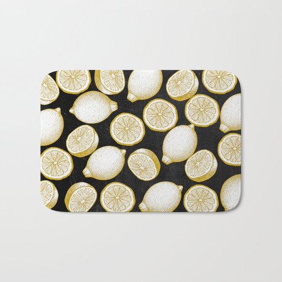 Lemons on black background Bath Mat