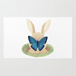 Butterfly resting on a bunny's nose Rug