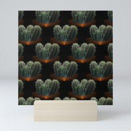 Desert of potted cacti at night Mini Art Print
