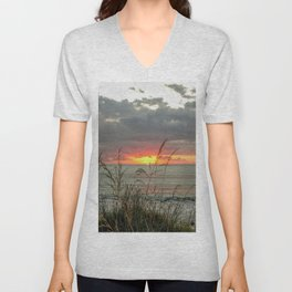 colorful sunset in new zealand on black sand and grass Unisex V-Neck