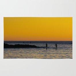 Paddleboarding  - Mackinzie Beach Yellow Sunset Rug