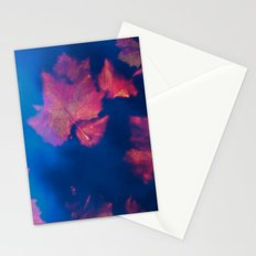 Rusty red falling leaves in dark blue water Stationery Cards