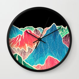 The glowing rocks of the mountains Wall Clock