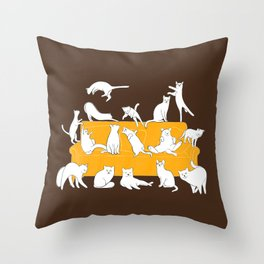 Cute cats on the yellow sofa | Brown Throw Pillow