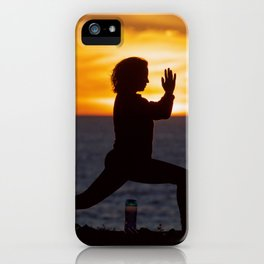 Living a healthy lifestyle doing yoga on a cliff at sunset. iPhone Case