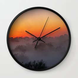 Sunrise with fog at an African river Wall Clock