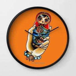 Hand Holding Matryoshka Wall Clock