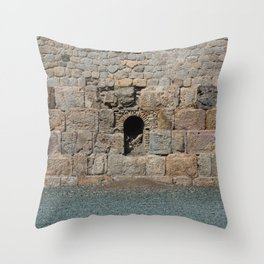 A stone wall in Cartagena, Spain Throw Pillow