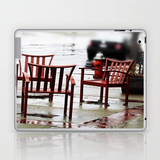Chairs Arranged in the Rain Laptop & iPad Skin