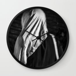 Muslim woman is walking Wall Clock