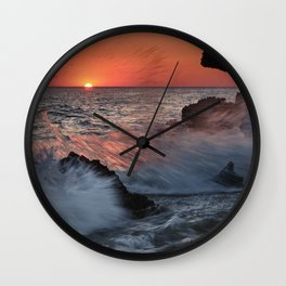 Red Sun Through The Waves. Roche Reefs At Sunset. Wall Clock
