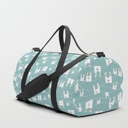 White bunnies on blue background Duffle Bag