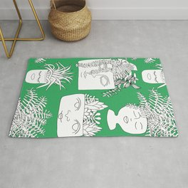Illustrated Plant Faces in Kelly Green Rug