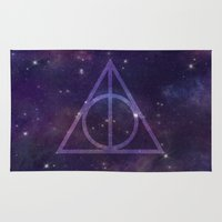 deathly hallows Area & Throw Rugs featuring Deathly Hallows in Space by Hannah Ison