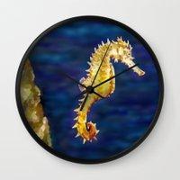 sea horse Wall Clocks featuring Sea horse by Michelle Behar